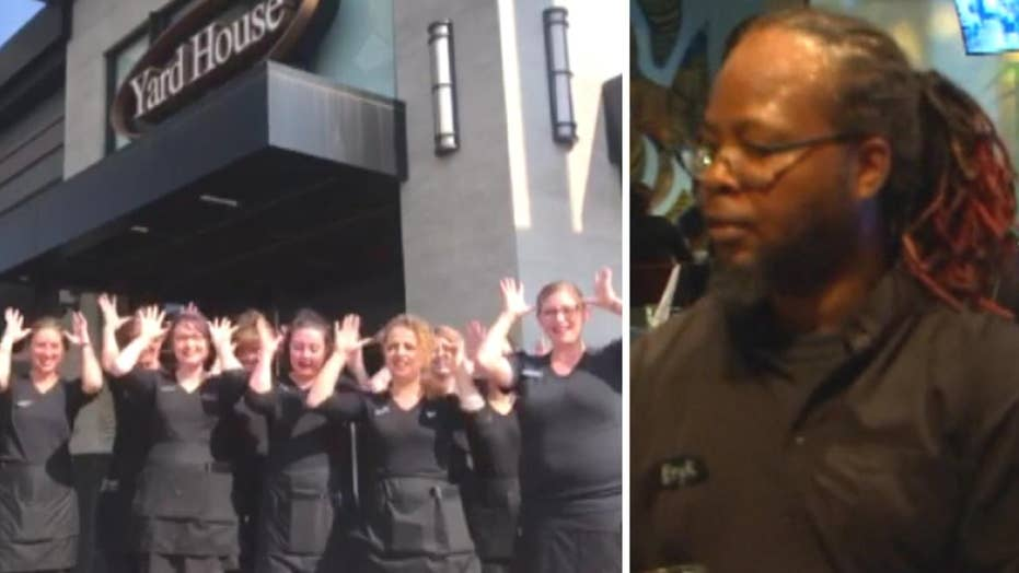 Restaurant staff sign happy birthday for deaf co-worker