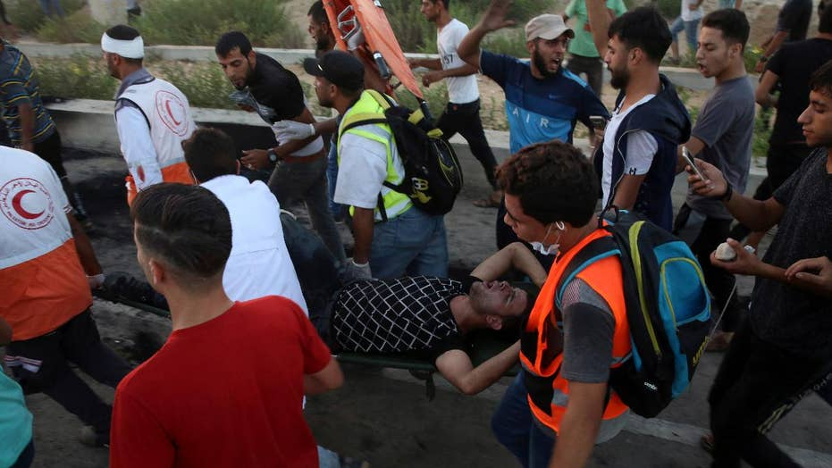 Thousands of protesters gather at Israel-Gaza border