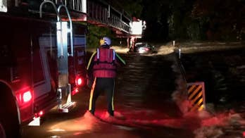 Firefighters in Texas save three people stuck inside a swamped Maserati -- one of eight water rescues by the Southlake first responders in a two-hour span.
