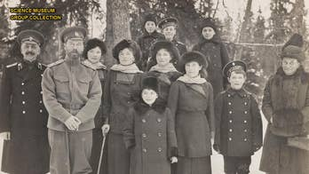 Dozens of candid photos showing Czar Nicholas II and the Romanov family boating and enjoying sleigh rides during the twilight years of their ill-fated dynasty, have gone on public display for the first time.