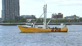An illegal immigrant from Mexico was charged with murder after one person was killed and two others were injured in a Sunday attack aboard a fishing vessel sailing off Massachusetts, officials said Monday.