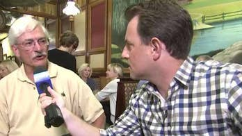 Todd Piro speaks to voters at Bread Basket Restaurant in Barrington, Illinois.