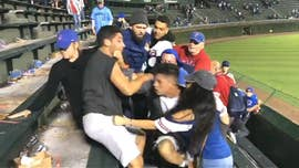 A wild fracas in the Wrigley Field bleachers occurred Monday and video of the incident showed one brawler hurling anti-Latino racial slurs at another man -- all while the Chicago Cubs were hosting Hispanic Heritage Night.