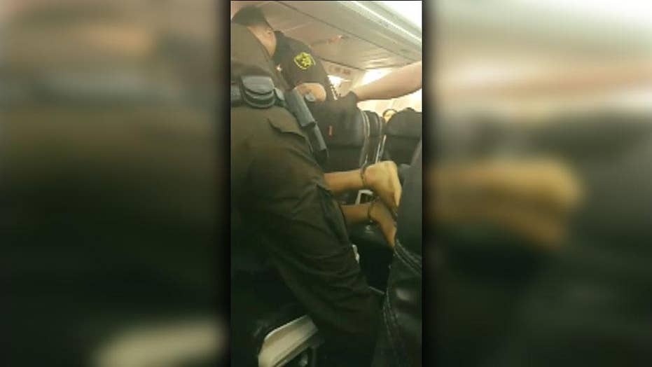 Disruptive airline passenger forcefully removed from plane
