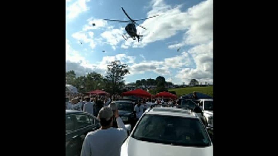 Police helicopter sends Penn State tailgate party flying