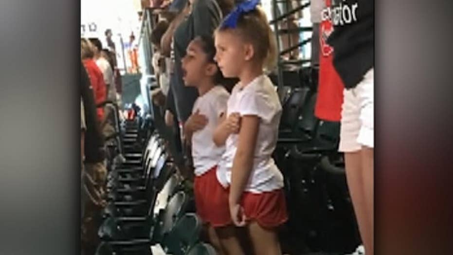 Little girl proudly sings national anthem at Astros game