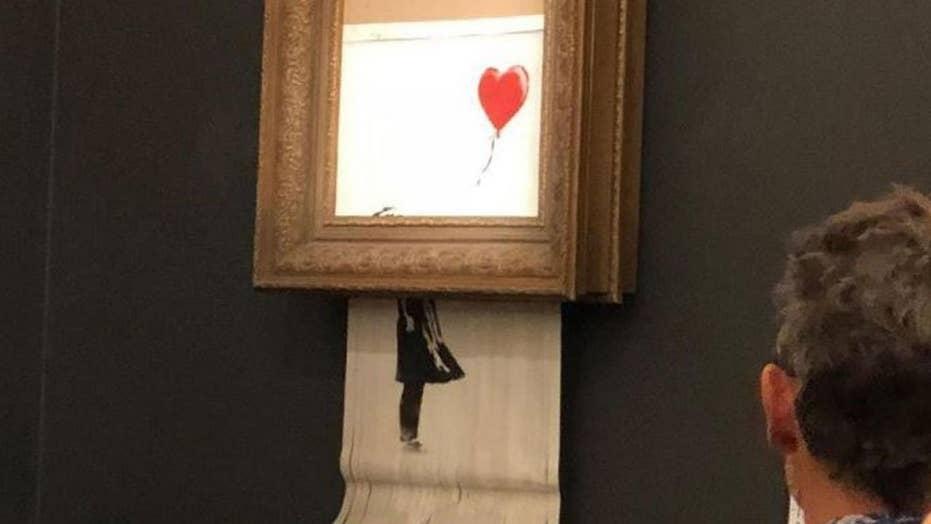 Banksy art sells for $1.4 million then self-destructs