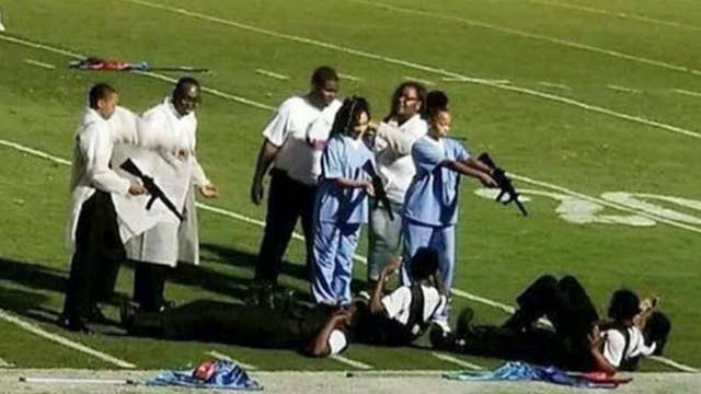 Marching band depicts murder of police officers at gunpoint
