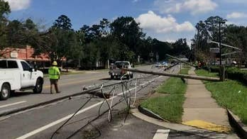 Crews work to clear power lines downed by Hurricane Michael