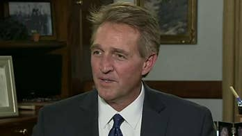 Flake calls Trump supporters' 'lock her up' chants 'disturbing,' and fears for future of Republican Party