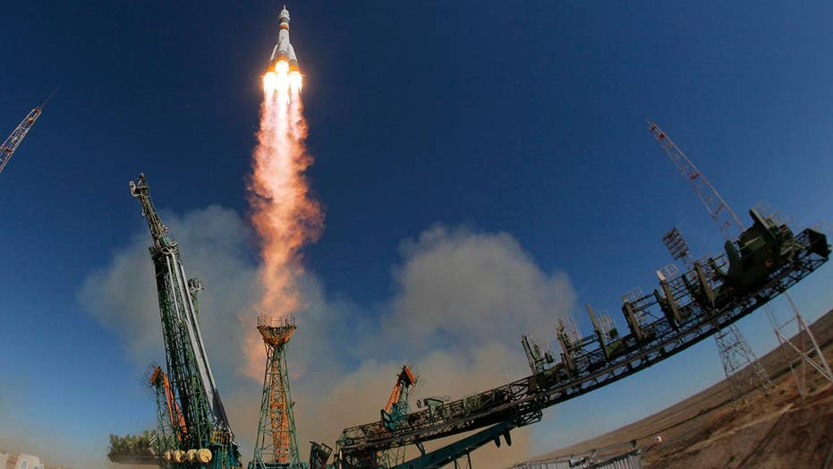 Astronauts safe after aborting booster rocket launch