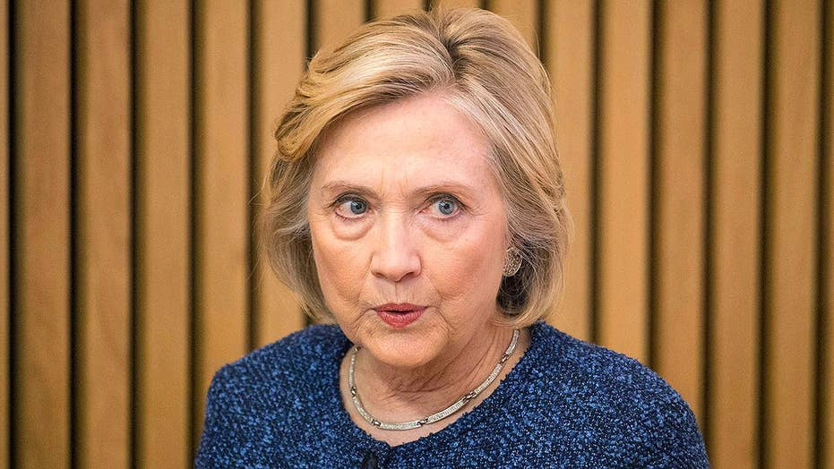 State Department: Clinton surrenders security clearance