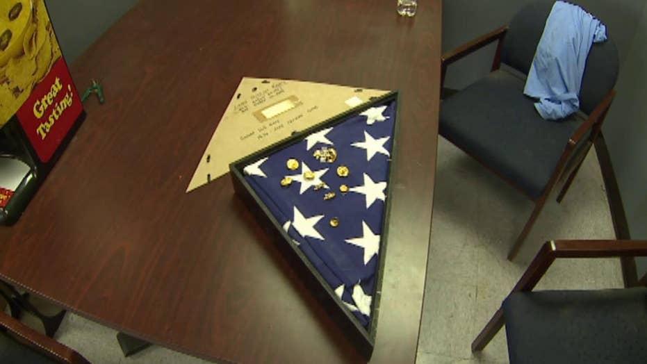 Navy veteran returns burial flag to fallen hero's widow
