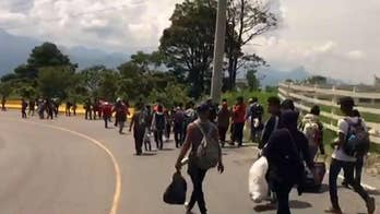 Over 1,500 Hondurans join caravan en route to US