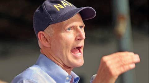 Rick Scott criticized for Navy hat