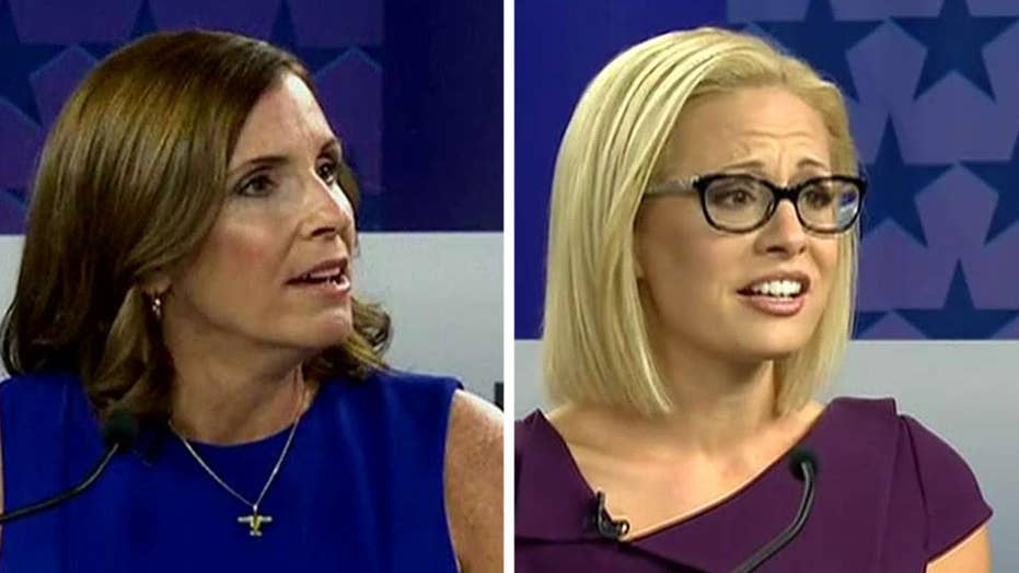 McSally accuses Sinema of supporting treason at fiery debate