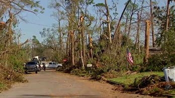 Crews work to clear toppled trees in Panama City, Florida