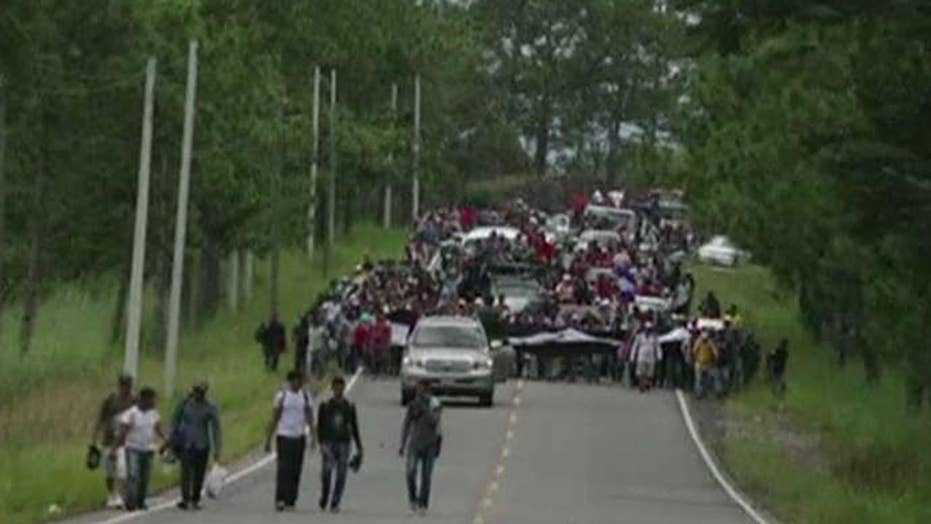 President Trump warns he'll cut funding to Central America