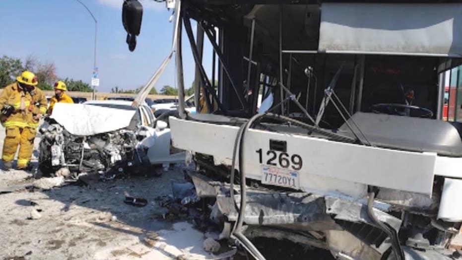 Bus crashes into concrete divider on California freeway