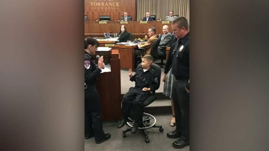 7-year-old sworn in as an honorary police officer