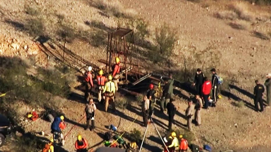 Arizona rescuers try save man stuck in 100-foot-deep mine