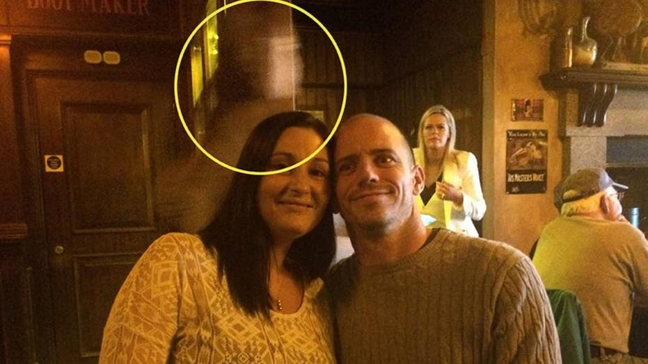 Tourist couple's photo contains eerie Titanic ghost?