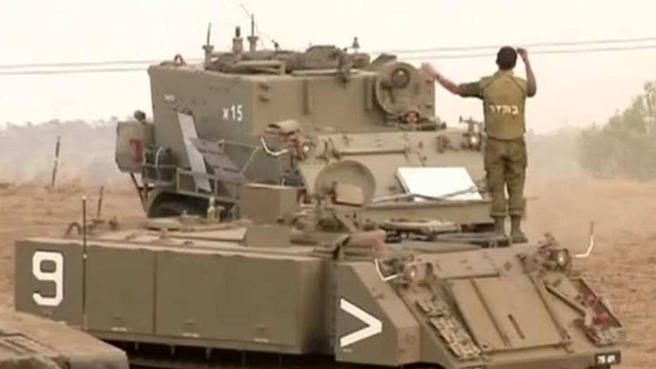 Israel gathers tanks on Gaza border to send message to Hamas