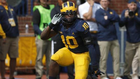 University of Michigan star seen damaging rival's logo