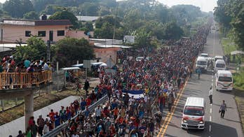 How long will it take for caravan to arrive at US border?
