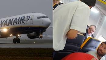 Ryanair passenger filmed using vulgar language toward seatmate claims he's 'not a racist'