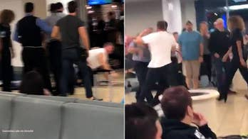 Intoxicated passenger at Orlando airport filmed fighting with JetBlue staff, resisting police