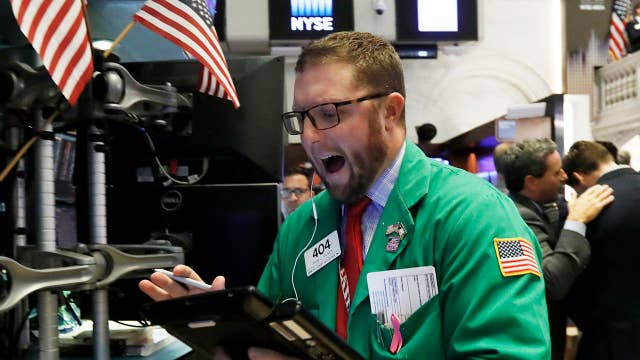 Dow enters busy earnings week; Taco Bell base promotion back
