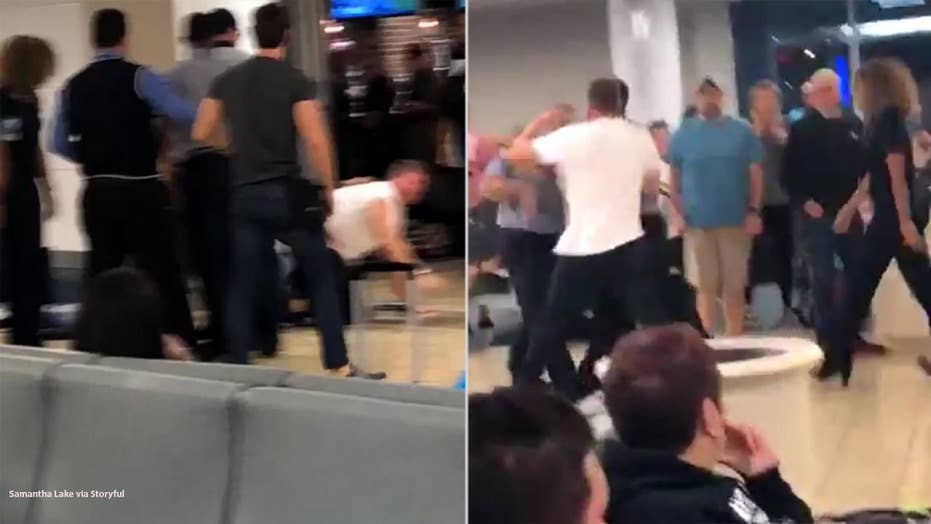 Intoxicated passenger at Orlando airport filmed fighting