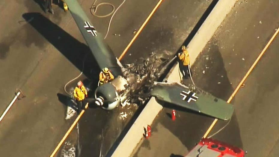 Vintage plane crashes on busy highway not far from Los Angeles