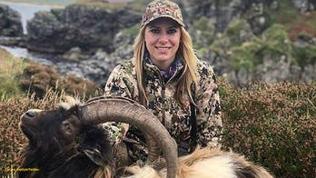 Hunter and host of 'Larysa Unleashed' slammed for posing with dead goat in Scotland