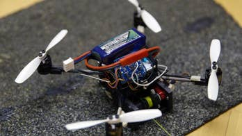 Tiny flying robots haul heavy loads in amazing video