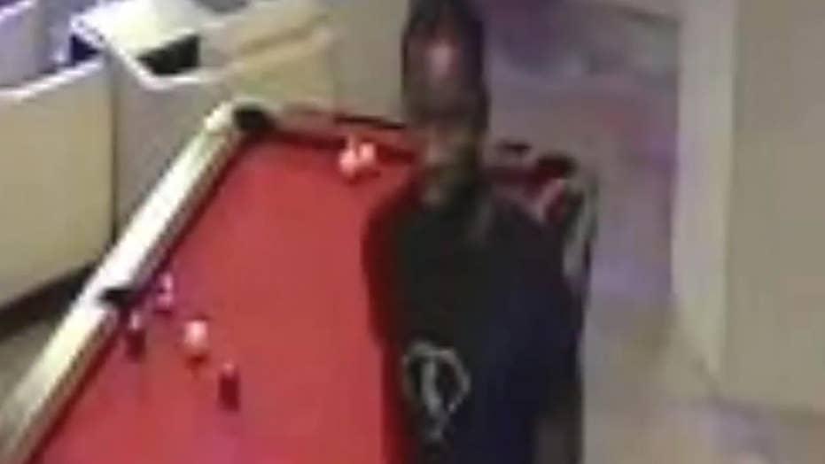Surveillance video: Suspect captured punching man at bar