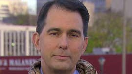Walker signs lame-duck bills into law in Wisconsin, amid accusations of power-grab from Dems