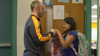 Teacher's unique handshakes go viral