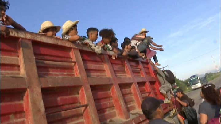 Migrants board trucks en route to Mexico City