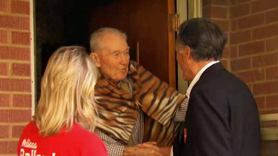 Mitt Romney goes door-to-door as he canvasses Salt Lake City