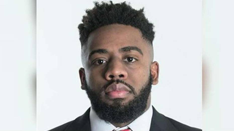 Rutgers football player charged in double murder plot