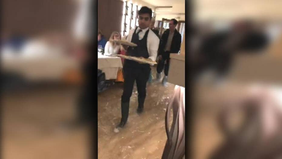 Pizzeria in Italy continues to serve food while flooded
