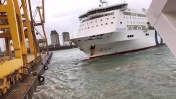 Ferry slams into crane in Barcelona port, sparking fire in shocking video