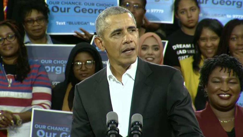 Obama takes GOP to task over caravan, military usage