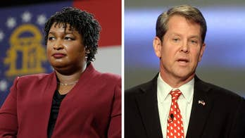 Georgia election fight heats up as Kemp declares victory and resigns secretary post, Abrams digs in