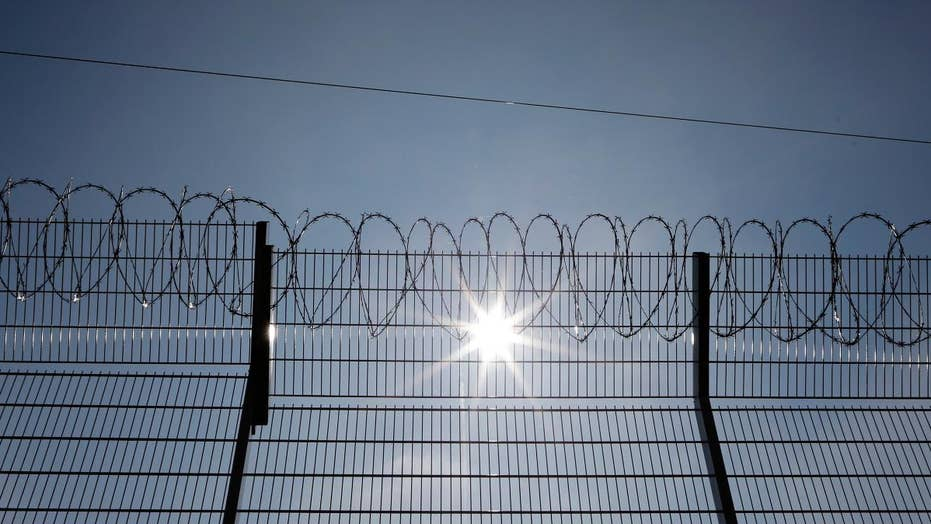 US troops put up barbed wire near Mexico border