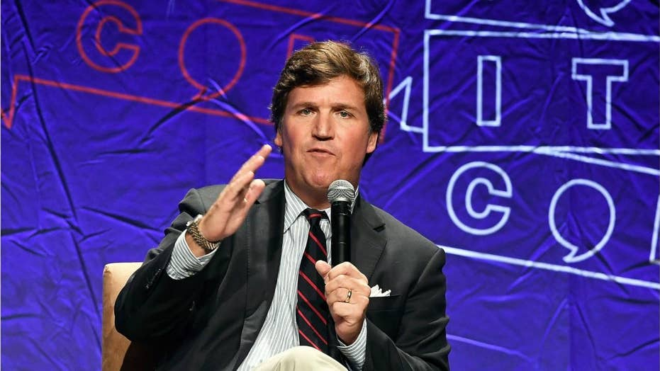 Mob chants threats outside Tucker Carlson's D.C. home