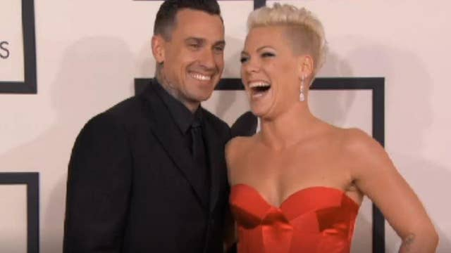 Pink's husband shares photo threatening to shoot looters after California fires