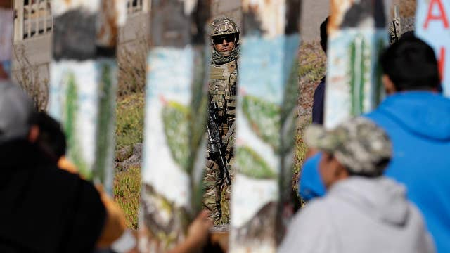 New focus on wall funding as migrants reach US border